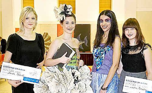 Fashion fix: Kingscliff TAFE student Sarah Follent (left) with sister Kate Follent (left) modelling her winning design.